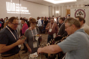 Dave Barber pours at the BevX Welcome Reception.