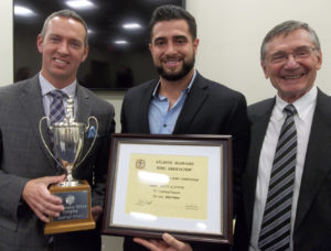 Stephen Heyns and Saam Bakhtiar accept the Jefferson Loving Cup Trophy for the 2018 grand prize winner CrossKeys Fiore 2017.